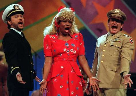 Billy Crystal, Whoopi Goldberg, and Robin Williams share a Comic Relief moment